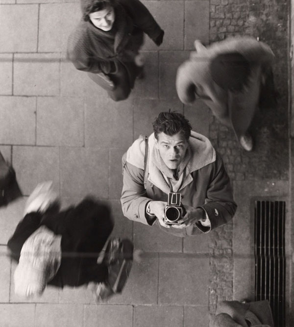 SELF-PORTRAIT WITH CAMERA, Ca. 1950